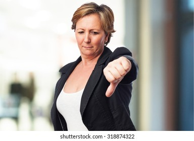 portrait of a mature business woman with thumb down