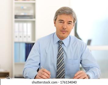 Portrait of mature businessman in office