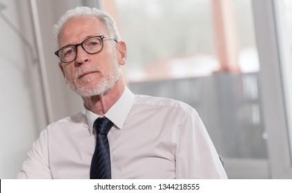 Portrait of mature businessman sitting in office