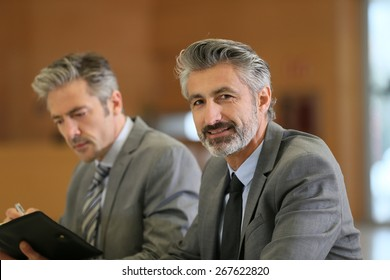 Portrait of mature businessman in a work meeting