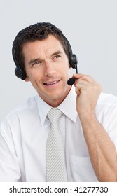 Portrait of a mature businessman working in a call center