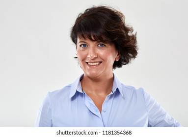 Portrait of a mature caucasian businesswoman on gray background
