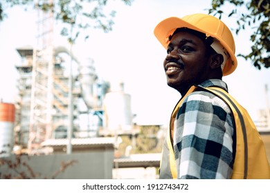 Portrait mature construction engineer man smiling confident with bright smile at site manager wearing hard hat and reflective vest in the garden. Positive thinking