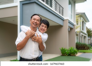 Portrait of mature couple after retirement relaxing in new house in they village