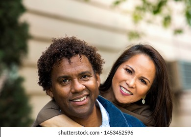 Portrait of a mature couple smiling.