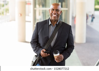 Portrait of a mature handsome African American businessman outside.