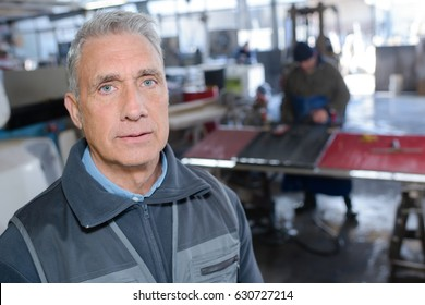 portrait of mature handyman at diy workshop