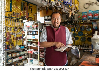 Portrait of mature latin entrepreneur man with retail business background.
