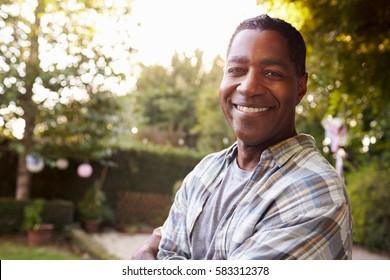 Portrait Of Mature Man In Back Yard Garden
