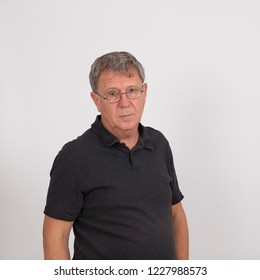 portrait of mature man in black shirt looking cool