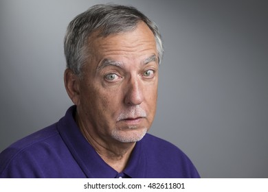 Portrait of a mature man looking confused, unsure