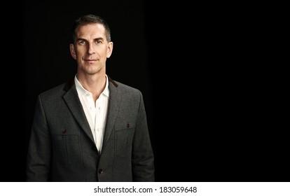 Portrait of a mature man on black background