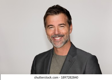 Portrait Of A Mature Man Smiling At The Camera. Isolated on white. Business.