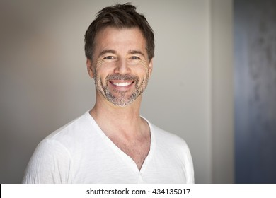 Portrait of a mature man smiling at the camera