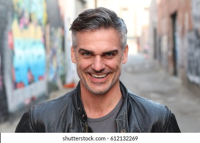 Portrait of a mature man smiling at the camera - Stock image