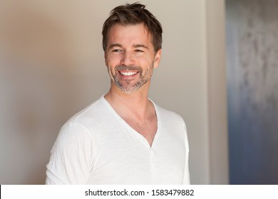 Portrait of a mature man smiling. Looking away. Really happy