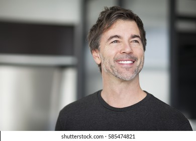 Portrait Of A Mature Man Smiling And looking away. Home