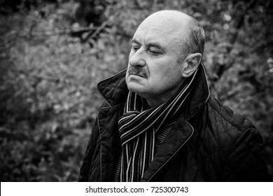 Portrait of mature man suffering for depression. Autumn memories, Portrait of a senior man thinking about something