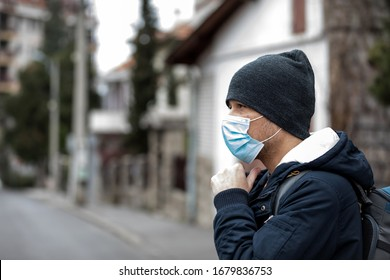 Portrait of Mature man wearing a protective mask, walking in the city.The image face of a young man wearing a mask to prevent germs, toxic fumes, and dust. Prevention of bacterial infection Corona vir