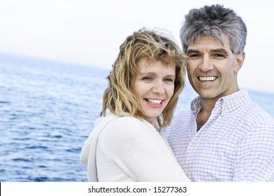 Portrait of mature romantic couple at seashore