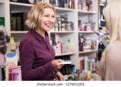 Portrait of mature store clerk at household and cosmetic shop