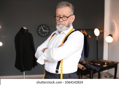 Portrait of mature tailor in atelier