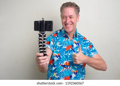 Portrait of mature tourist man ready for vacation