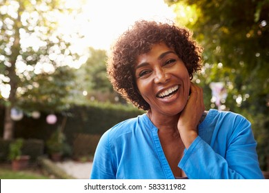 Portrait Of Mature Woman In Back Yard Garden