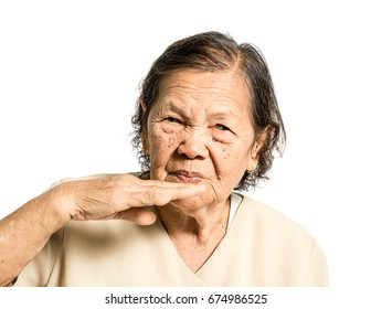 Portrait of a mature woman with bad smell expression. Isolated on white background with clipping path