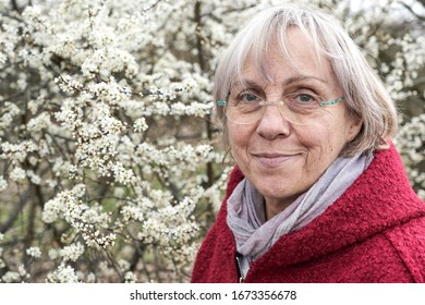 Portrait of mature woman with blooming tree