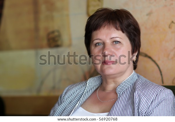 Portrait of mature woman at a cafe