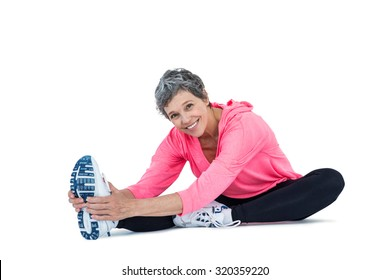 Portrait of mature woman exercising over white background