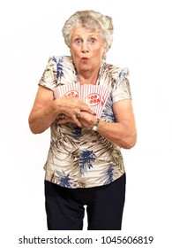 Portrait Of Mature Woman Holding Popcorn Isolated On White Background