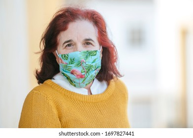 Portrait of mature woman with protective mask