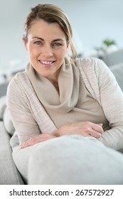 Portrait of mature woman relaxing in sofa