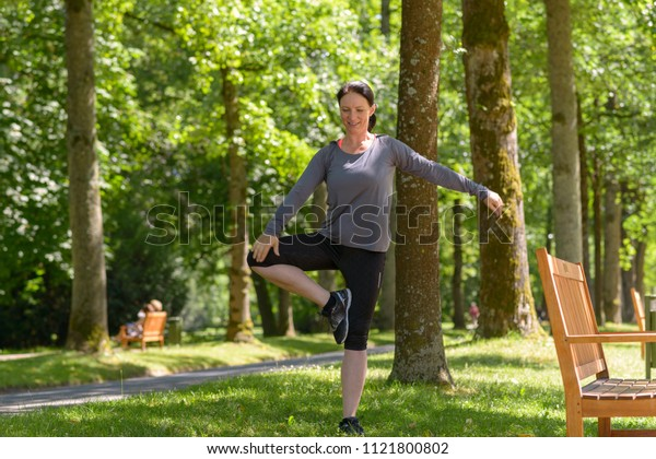 Portrait of mature woman relaxing while practising yoga pose