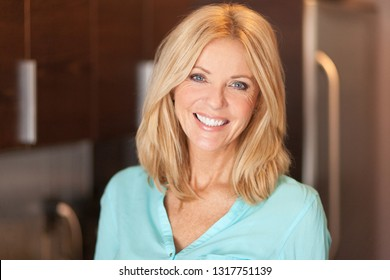 Portrait of a mature woman smiling at the camera. She is confident and proud