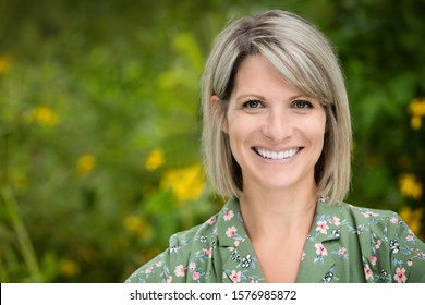 Portrait Of A Mature Woman Smiling at the camera. She is really happy