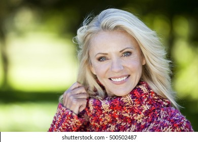 Portrait Of A Mature Woman Smiling At the Camera At The Park