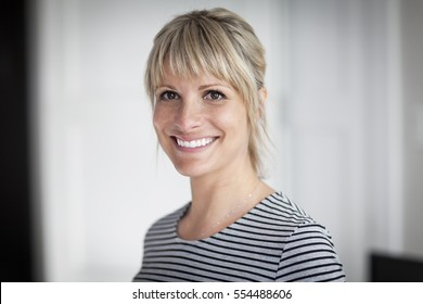 Portrait Of A Mature Woman Smiling At The Camera At Home