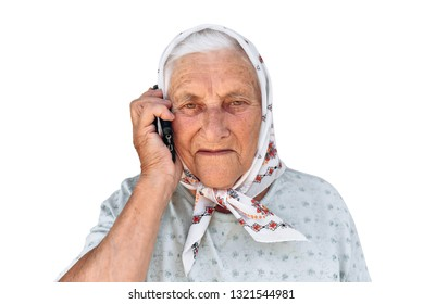 Portrait of mature woman talking on smartphone outdoor. Senior woman smiling and talking on the phone at park. Close up face of a cheerful elderly woman on phone call. Cat on a white background