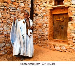 Portrait of mauritanian man in national costume boubou or derraa -  10.11.2012 Chinguetti, Mauritania