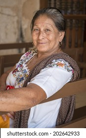 Portrait of a Mayan woman in Yucatan. Sincere and deep smile of a native woman in Yucatan, Mexico