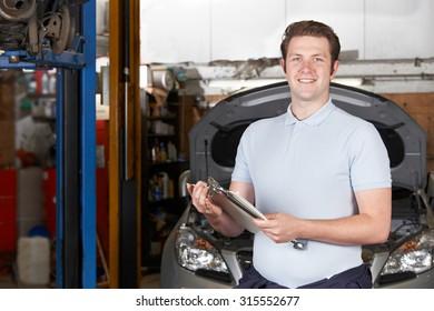 Portrait Of Mechanic In Auto Repair Shop