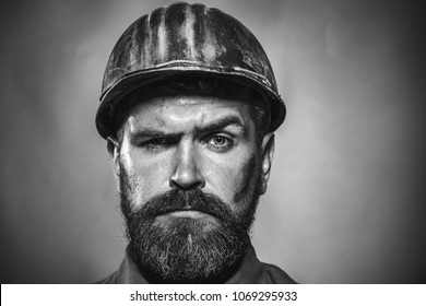 Portrait mechanical worker. Bearded man in suit with construction helmet. Portrait of handsome engineer. Construction worker in hardhat. Business, industry, technology - builder concept. Black&white.