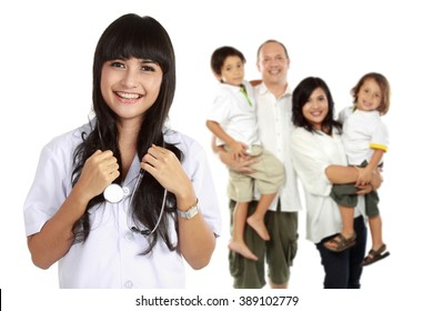portrait of medical doctor and  patient in the background. healthy family concept