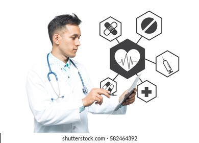 Portrait of a medical doctor standing near a concrete wall with black and white round medical images.