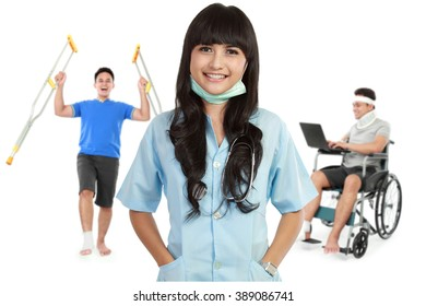 portrait of medical female doctor and patient using wheel chair and crutch at the background