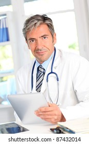 Portrait of medical people using electronic tablet