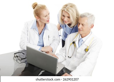 Portrait of medical team sitting in front of computer and consulting. Isolated on white background.
